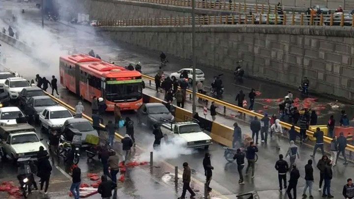 Iranian citizens protesting a petrol price hike