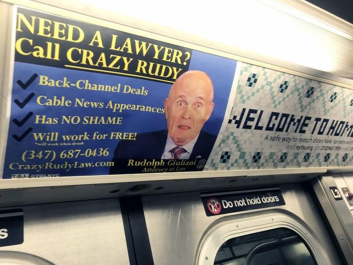 Anti-Giuliani banners in the NY City subway