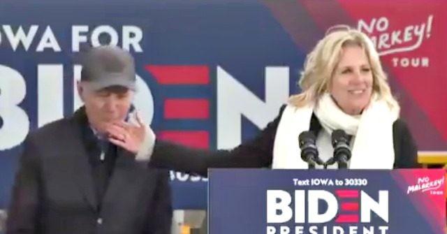 Joe Biden nibbles his wife