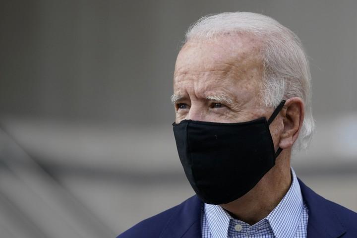 Biden, flush with cash, boosts ad spending in battlegrounds