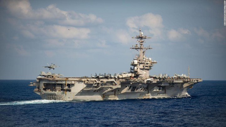 Sailors who had returned to pandemic-stricken aircraft carrier retest positive for coronavirus