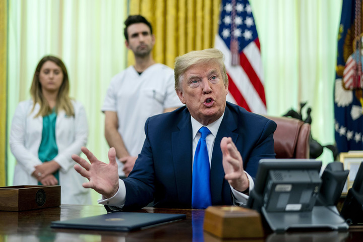Trump contradicts nurse in testy Oval Office exchange over coronavirus protective gear