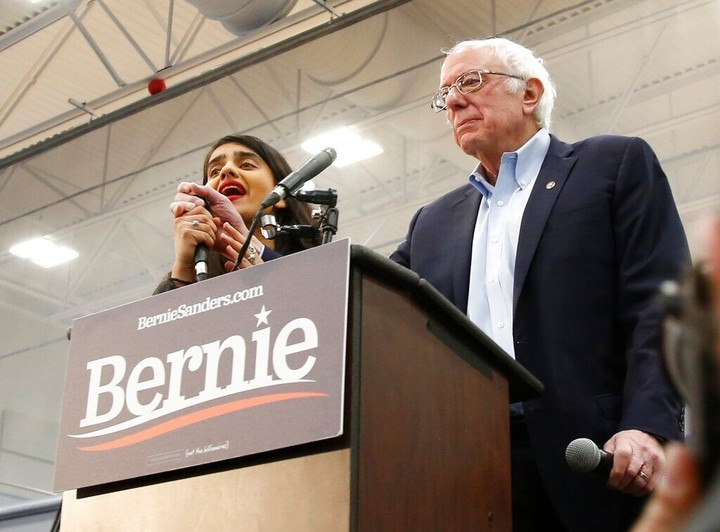 Sanders interrupted by topless protesters