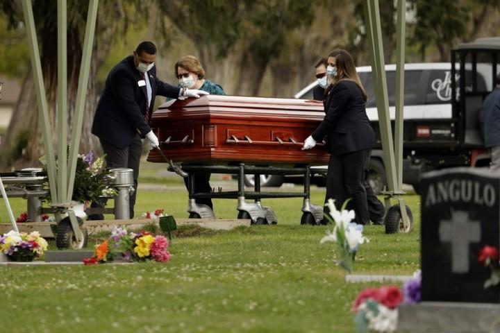 Little sense of shared grief as virus deaths near 100,000