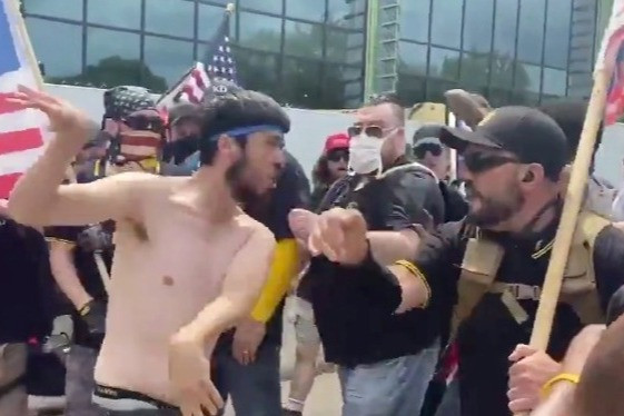 Shock moment right-wing Proud Boys group and Antifa protesters brawl on street