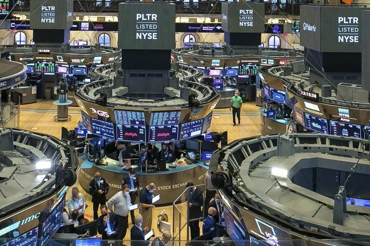 Secretive, never profitable Palantir makes market debut