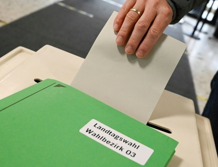 Merkel party suffers heavy losses in German state polls