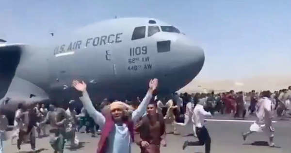 Desperate Afghan 'Helpers' Cling to Planes as U.S. Abandons Them at Kabul's Airport
