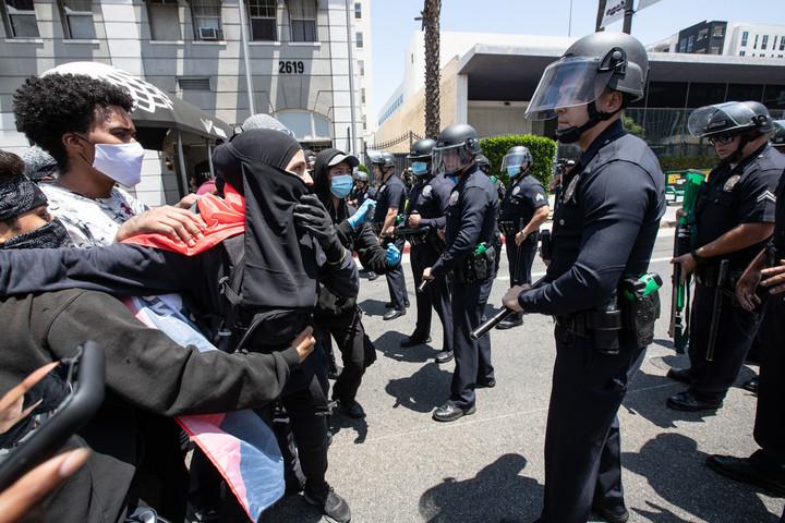 Riot police break up dueling transgender rights protests outside LA spa