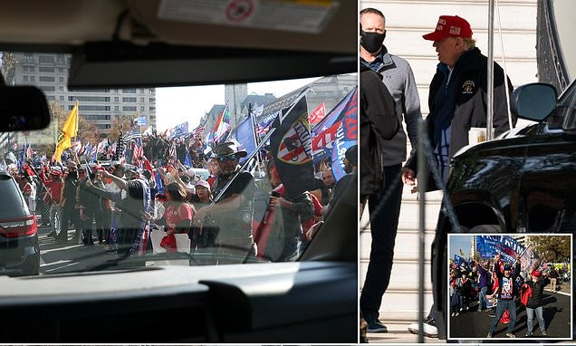 Trump fans cheer the President's motorcade at the 'Million MAGA March'