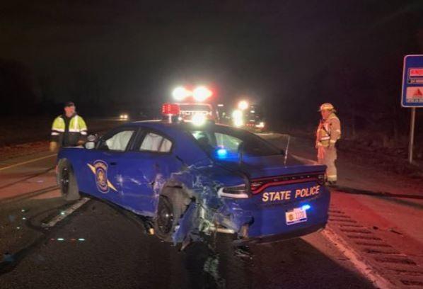 Tesla on autopilot crashes into state police patrol car in Lansing
