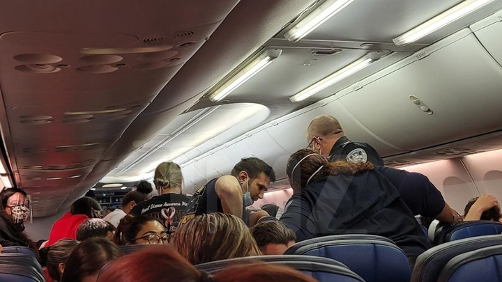 United Passenger Dies After Lying About COVID Symptoms, Photos Show Chaos